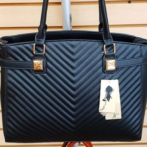 Black quilted purse with chevron design